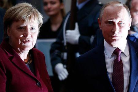German Chancellor Merkel welcomes Russian President Putin for talks on a stalled peace plan for eastern Ukraine at the chancellery in Berlin
