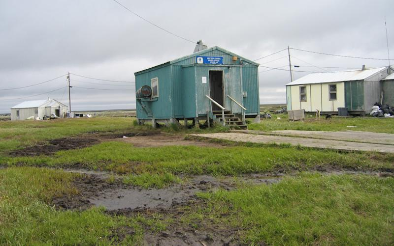 In this 2006 photo provided by the State of Alaska Department of Commerce, a post office in Newtok, Alaska is shown. The flood-prone village of Newtok near Alaska's storm-battered coast is running out of time as coastal erosion creeps ever closer to the Yup'ik Eskimo community. As residents wait for a new village to be built on higher ground nine miles away, a dispute over who is in charge has led to a rare intervention by the Bureau of Indian Affairs, which ruled that the sitting tribal council no longer represents the community of 350 as far as the agency is concerned. (AP Photo/State of Alaska)