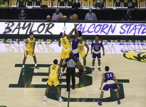 Baylor forward Flo Thamba (0) and Alcorn State forward Anthony Fairley (4) tip off in the in the first half of an NCAA college basketball game, Wednesday, Dec. 30, 2020, in Waco, Texas. (AP Photo/ Jerry Larson)