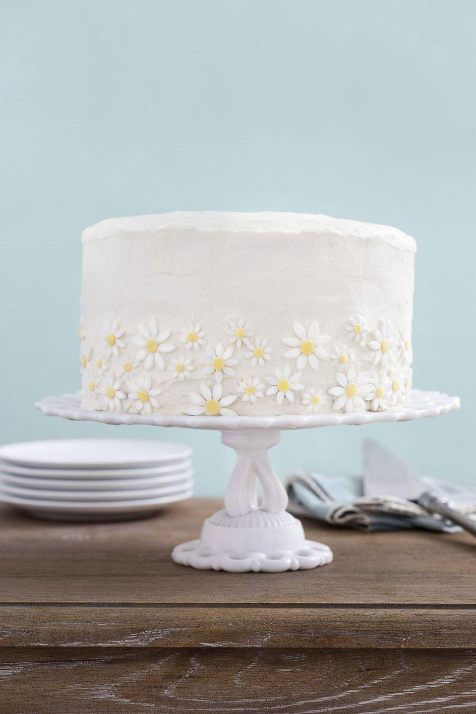 "<p>Fondant daisies (either homemade or store-bought!) make this three-tier cake centerpiece-worthy.</p><p><em><a href=""https://www.countryliving.com/food-drinks/recipes/a35037/lemon-coconut-cake-with-mascarpone-frosting/"" rel=""nofollow noopener"" target=""_blank"" data-ylk=""slk:Get the recipe from Country Living »"" class=""link rapid-noclick-resp"">Get the recipe from Country Living »</a></em></p>"