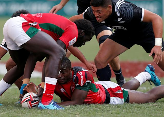 Rugby Union - Kenya v New Zealand - World Rugby Sevens Series - Hong Kong Stadium, Hong Kong, China - April 8, 2018 - Kenya's Willy Ambaka reaches for the ball. REUTERS/Bobby Yip