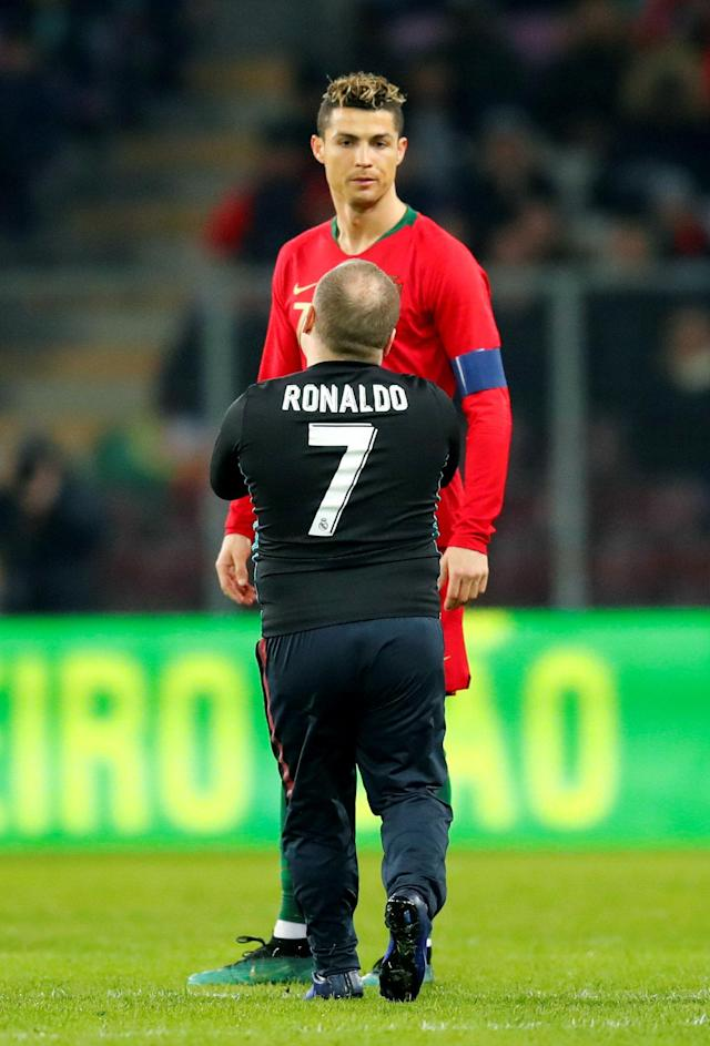Soccer Football - International Friendly - Portugal vs Netherlands - Stade de Geneve, Geneva, Switzerland - March 26, 2018 Portugal's Cristiano Ronaldo with a pitch invader REUTERS/Denis Balibouse TPX IMAGES OF THE DAY
