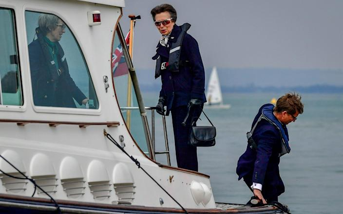The Princess Royal arrives by boat to the Royal Victoria Yacht Club, on the Isle of Wight - PA