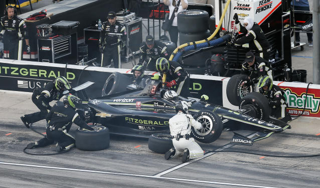 Josef Newgarden makes a pit stop during the IndyCar auto race at Texas Motor Speedway, Saturday, June 8, 2019, in Fort Worth, Texas. (AP Photo/Brandon Wade)