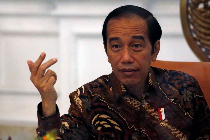 Indonesian President Joko Widodo gestures during an interview with Reuters at the presidential palace in Jakarta