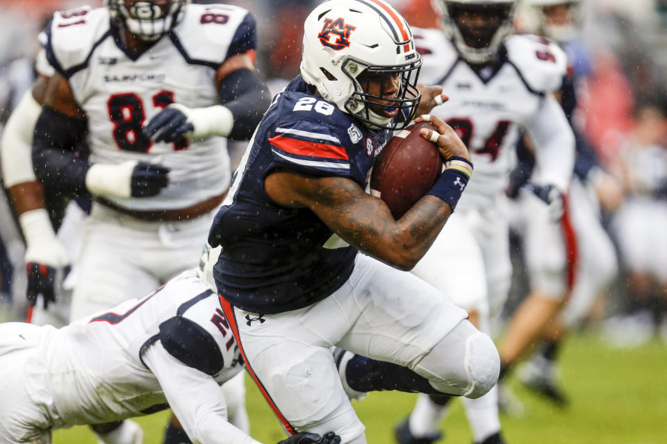 Auburn running back JaTarvious Whitlow (28) carries the ball against Samford during the first half of an NCAA college football game, Saturday, Nov. 23, 2019, in Auburn, Ala. (AP Photo/Butch Dill)