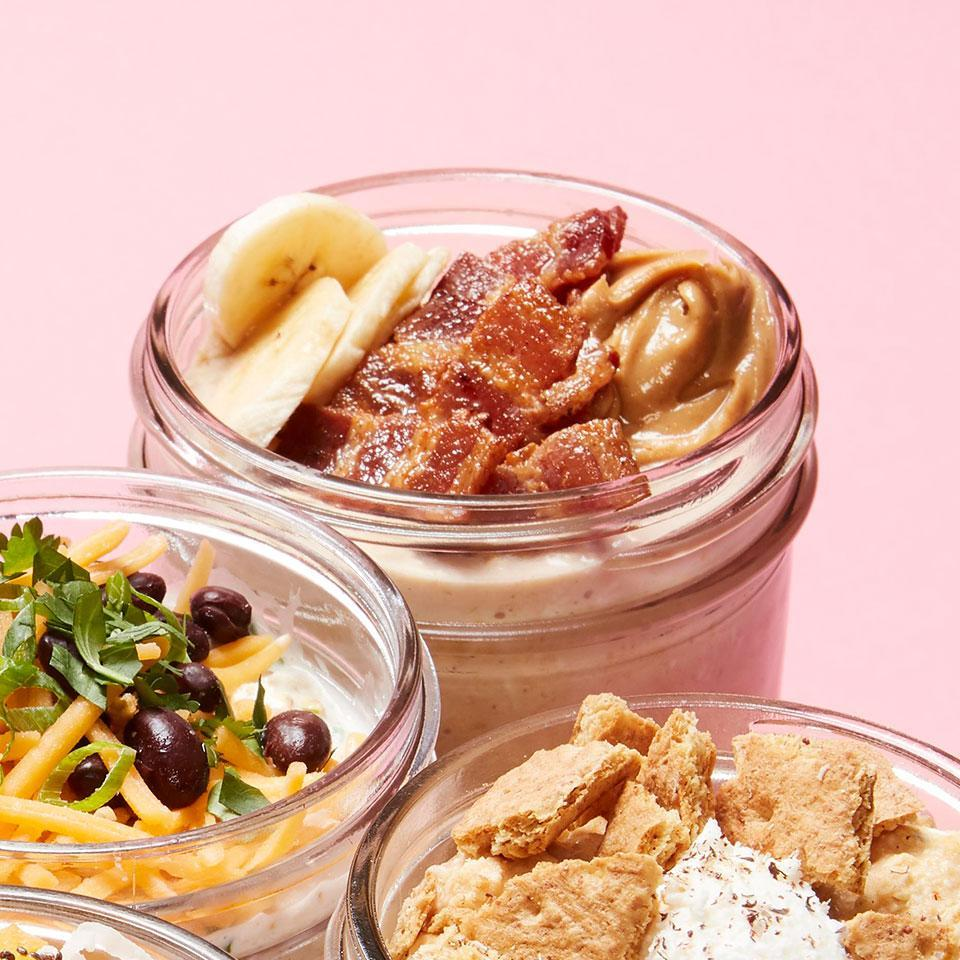 """<p>We've taken classic Elvis-sandwich flavors--banana, bacon and peanut butter--and stirred them into easy overnight oats in this healthy breakfast recipe. Make a bunch of jars at the beginning of the week for ready-when-you are morning meals all week long. <a href=""""https://www.eatingwell.com/recipe/270490/peanut-butter-banana-bacon-overnight-oats/"""" rel=""""nofollow noopener"""" target=""""_blank"""" data-ylk=""""slk:View Recipe"""" class=""""link rapid-noclick-resp"""">View Recipe</a></p>"""