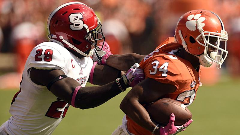 Clemson survives NC State's upset bid with interception in overtime