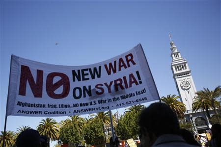 Demonstrators rally during an anti-war rally in San Francisco, California September 7, 2013. REUTERS/Stephen Lam
