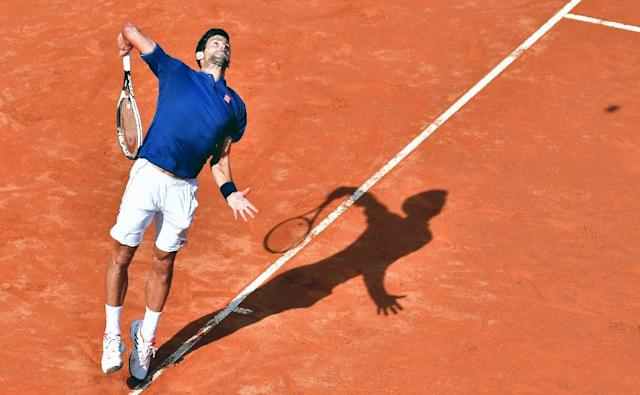 Novak Djokovic of Serbia serves to Roberto Bautista during their third round match at the ATP Tennis Open tournament on May 18, 2017 at the Foro Italico in Rome, Italy (AFP Photo/TIZIANA FABI)