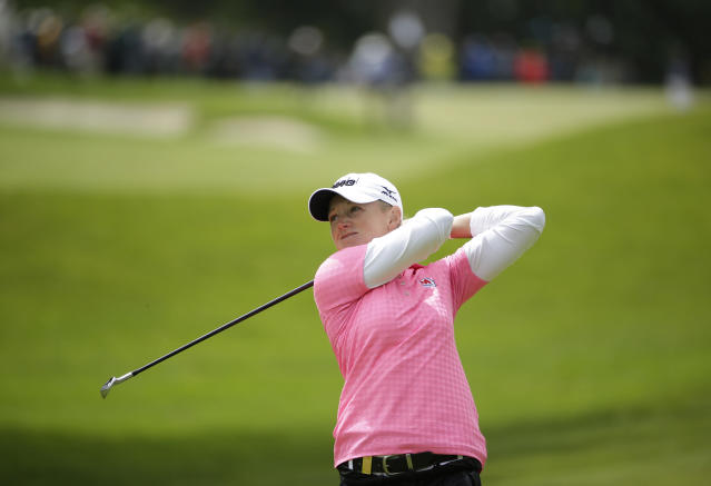Stacy Lewis hits from the fourth fairway of the Lake Merced Golf Club during the third round of the Swinging Skirts LPGA Classic golf tournament on Saturday, April 26, 2014, in Daly City, Calif. (AP Photo/Eric Risberg)