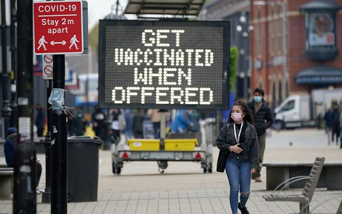 Coronavirus signs in Bolton town centre in Bolton, England, which is one of the eight areas experiencing a spike in cases - Christopher Furlong/Getty Images