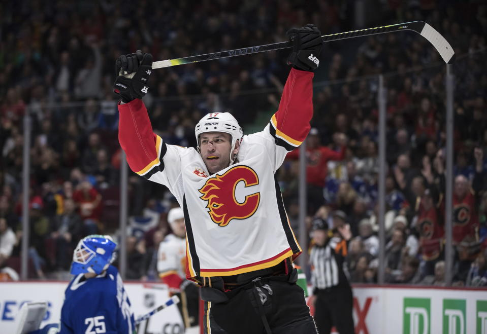 Calgary Flames' Milan Lucic celebrates his goal against Vancouver Canucks goalie Jacob Markstrom, left, of Sweden, during the third period of an NHL hockey game Saturday, Feb. 8, 2020, in Vancouver, British Columbia. (Darryl Dyck/The Canadian Press via AP)