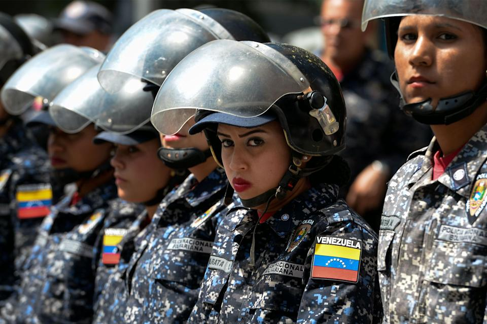 Members of the Bolivarian National Police (PNB) stand guard near 'Dr. JM de los Rios' Children's Hospital in Caracas, during a protest against the government of President Nicolas Maduro and in demand of humanitarian aid, called by opposition leader and self-proclaimed 'acting president' Juan Guaido, on January 30, 2019. (Photo: FEDERICO PARRA/AFP/Getty Images)