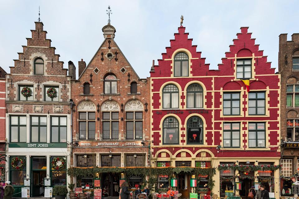 """Europe's <a href=""""https://www.cntraveler.com/galleries/2015-02-12/bruges-moderne-the-hip-new-side-of-a-medieval-city?mbid=synd_yahoo_rss"""" rel=""""nofollow noopener"""" target=""""_blank"""" data-ylk=""""slk:best-preserved medieval city"""" class=""""link rapid-noclick-resp"""">best-preserved medieval city</a> is also one of its most charming, especially during the <a href=""""https://www.cntraveler.com/galleries/2015-12-08/copenhagen-to-quebec-14-cities-that-do-christmas-best?mbid=synd_yahoo_rss"""" rel=""""nofollow noopener"""" target=""""_blank"""" data-ylk=""""slk:holiday season"""" class=""""link rapid-noclick-resp"""">holiday season</a>. Let's start with its light displays, when every tree and storefront seems ablaze with twinkle lights (just look up as you wander the cobblestone streets). When your fingers start going numb, warm up with mugs of Belgian hot chocolate in the historic <a href=""""https://www.craenenburg.be/en/welcome"""" rel=""""nofollow noopener"""" target=""""_blank"""" data-ylk=""""slk:Craenenburg Cafe"""" class=""""link rapid-noclick-resp"""">Craenenburg Cafe</a>."""