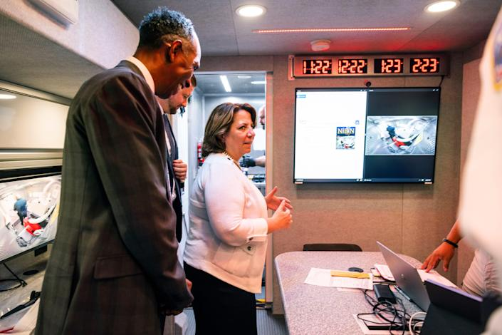 Deputy Attorney General Lisa Monaco and Alcohol, Tobacco and Firearms (ATF) acting director Marvin G. Richardson tour an ATF crime gun intelligence mobile command center, which provides investigators with ballistic processing at crime scenes, in Washington, on Thursday, July 22, 2021.