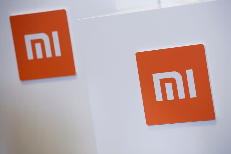 FILE PHOTO: FILE PHOTO: Xiaomi logos are displayed during a news conference in Hong Kong