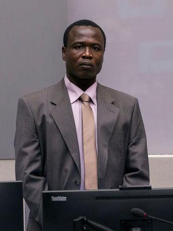 Dominic Ongwen, a former senior rebel commander from the Lord's Resistance Army in Uganda, stands in the courtroom of the International Criminal Court (ICC) during the confirmation of charges in The Hague, the Netherlands January 21, 2016. REUTERS/Michael Kooren/File Photo