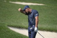 Bryson DeChambeau reacts after chipping onto the first green during the second round of the BMW Championship golf tournament, Friday, Aug. 27, 2021, at Caves Valley Golf Club in Owings Mills, Md. (AP Photo/Nick Wass)