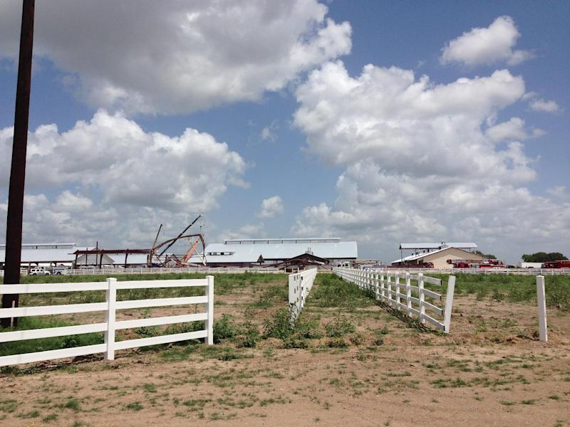 This photo provided by KBTX-TV shows damage to the Texas A&M University equestrian center on Saturday, June 22, 2013 near College Station, Texas. A portion of the equestrian center under construction has collapsed. KBTX-TV reports some workers were hurt in Saturday morning's accident but that everyone has been accounted for. A&M spokesman Lane Stephenson confirmed there had been an accident at the equestrian center on university property about a mile from the College Station campus. (AP Photo/KBTX-TV, Alex Lotz)