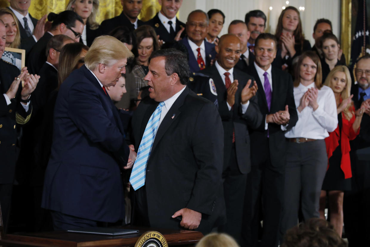 President Trump greets New Jersey Gov. Chris Christie at the White House after speaking about the administration's plans to combat the nation's opioid crisis on Oct. 26. (Photo: Carlos Barria/Reuters)