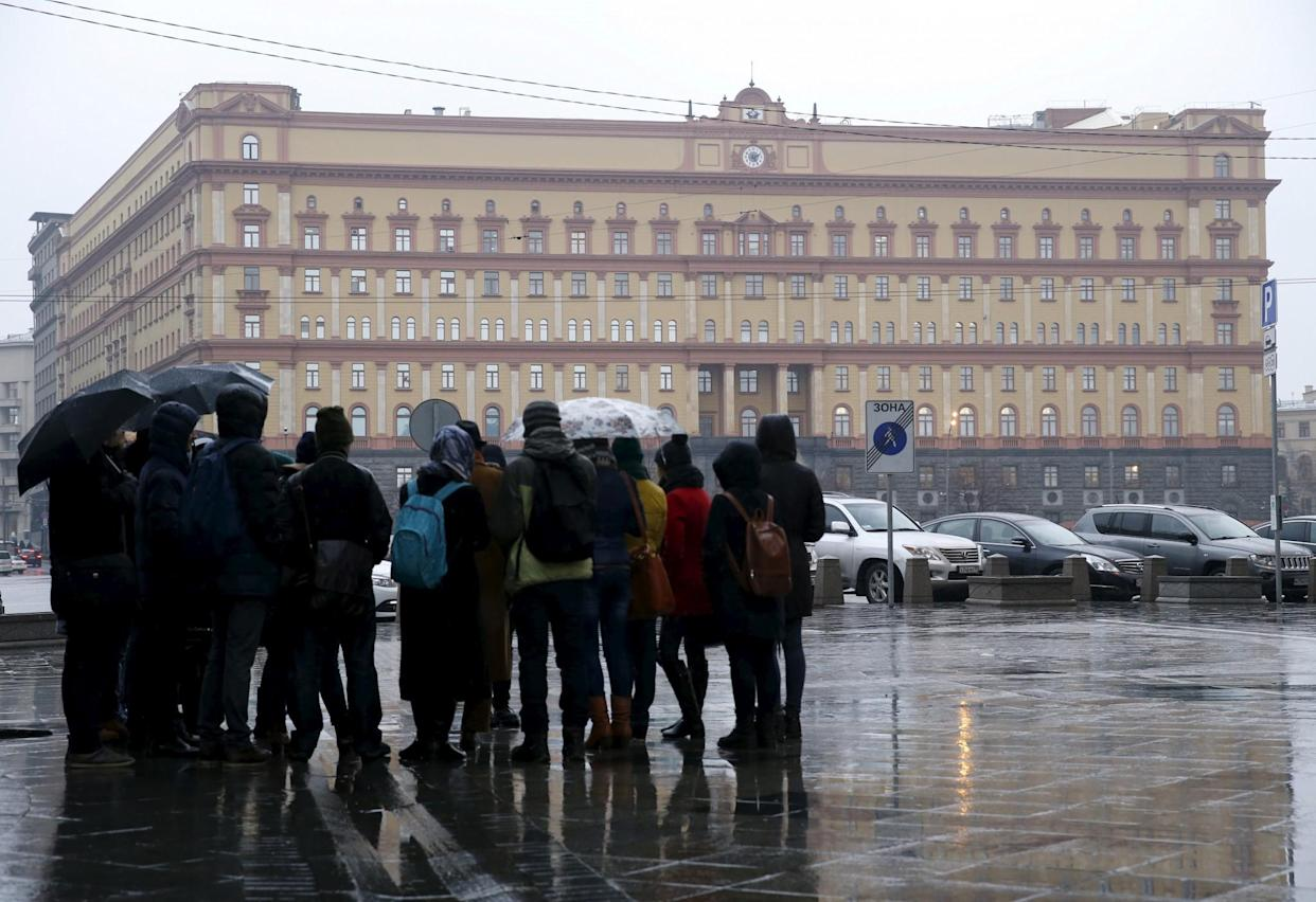 People gather near the headquarters of the Federal Security Service in Moscow. (Photo: Sergei Karpukhin/Reuters)