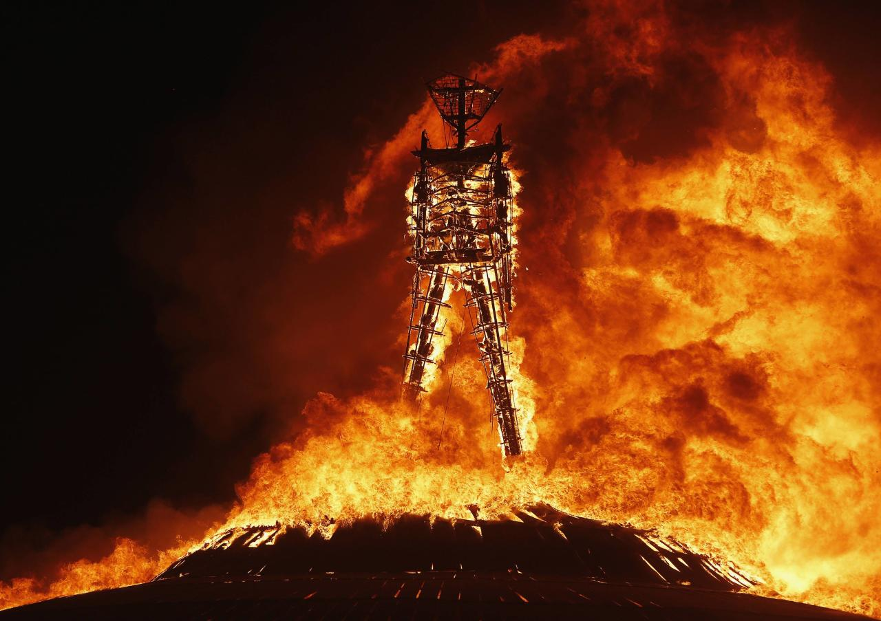 The Man burns during the Burning Man 2013 arts and music festival in the Black Rock Desert of Nevada, August 31, 2013. The federal government issued a permit for 68,000 people from all over the world to gather at the sold out festival, which is celebrating its 27th year, to spend a week in the remote desert cut off from much of the outside world to experience art, music and the unique community that develops. REUTERS/Jim Urquhart (UNITED STATES - Tags: SOCIETY) FOR USE WITH BURNING MAN RELATED REPORTING ONLY. FOR EDITORIAL USE ONLY. NOT FOR SALE FOR MARKETING OR ADVERTISING CAMPAIGNS. NO THIRD PARTY SALES. NOT FOR USE BY REUTERS THIRD PARTY DISTRIBUTORS