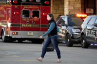A shopper leaves the Mayfair Mall after a shooting, Friday, Nov. 20, 2020, in Wauwatosa, Wis. Multiple people were shot Friday afternoon at the mall, and police are still searching for the shooter. (AP Photo/Nam Y. Huh)