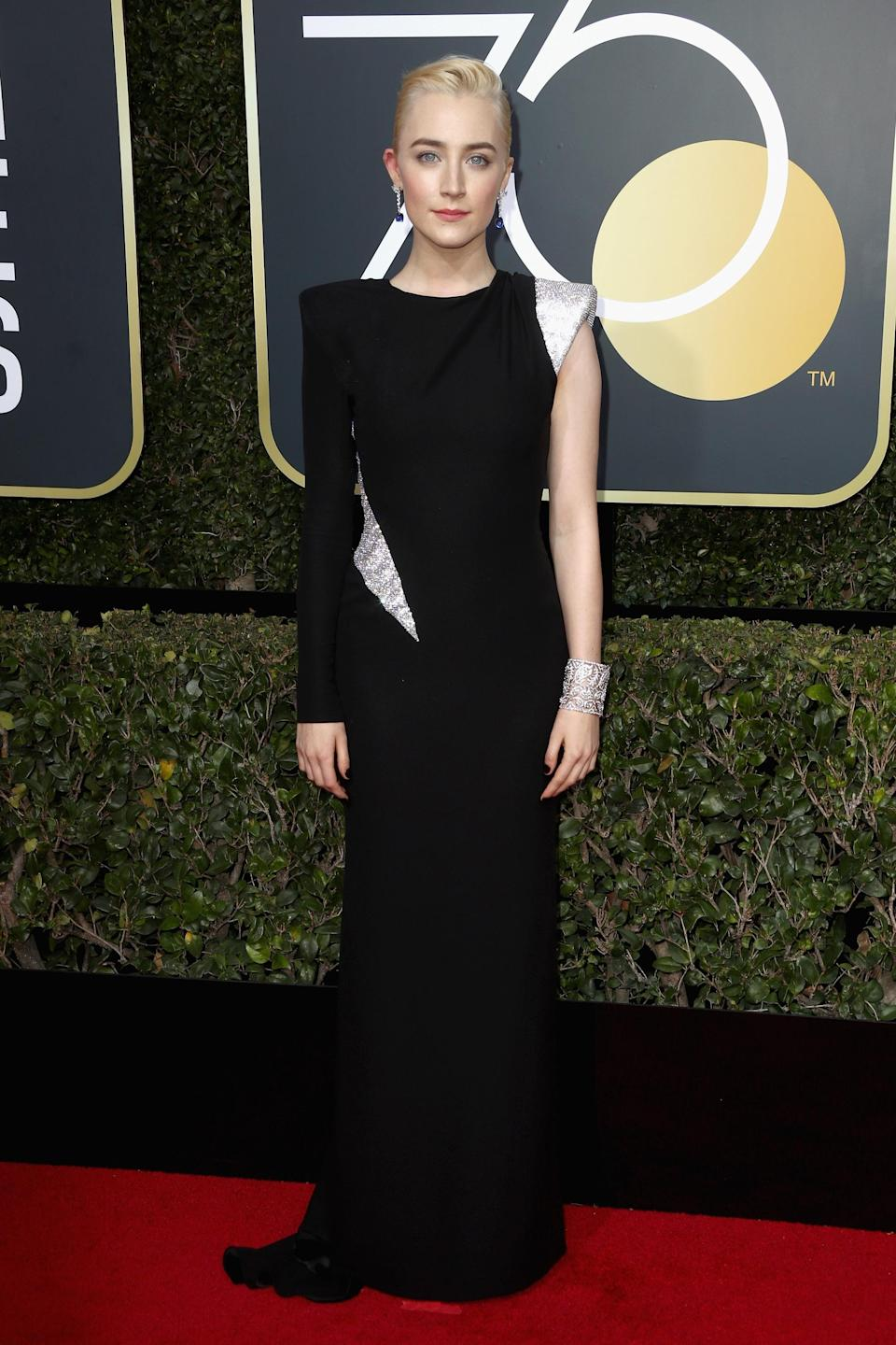 """<strong><h2>2018</h2></strong><br>Hands down, 2018 was Saoirse Ronan's year. Not only did she win her very first Golden Globe for a stunning performance in <em>Lady Bird</em>, but she also shut the red carpet down in this stunning black and silver Atelier Versace gown.<br><br><em>Saoirse Ronan in Atelier Versace.</em><span class=""""copyright"""">Photo: Frederick M. Brown/Getty Images.</span>"""