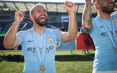 Sergio Aguero of Manchester City celebrates becoming 2019 Champions after the Premier League match between Brighton & Hove Albion and Manchester City - Credit: GETTY IMAGES