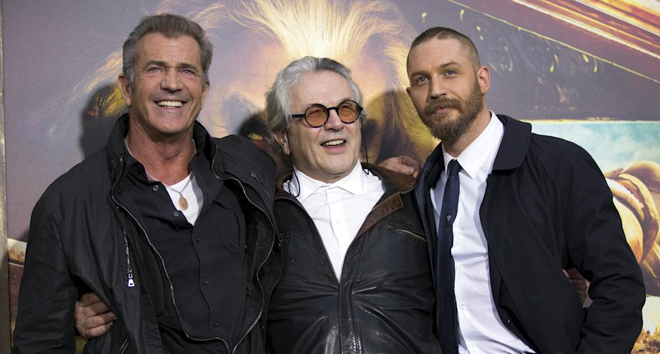 """Director of the movie George Miller (C) poses with cast member Tom Hardy (R) and actor Mel Gibson at the premiere of """"Mad Max: Fury Road"""" in Hollywood, California May 7, 2015. The movie opens in the U.S. on May 15.  REUTERS/Mario Anzuoni"""