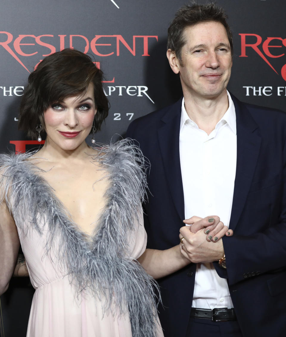 """Milla Jovovich, left, and writer/director Paul W.S. Anderson arrive at the world premiere of """"Resident Evil: The Final Chapter"""" at Regal L.A. Live on Monday, Jan. 23, 2017, in Los Angeles. (Photo by Rich Fury/Invision/AP)"""