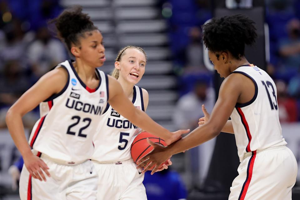 UConn players celebrate.