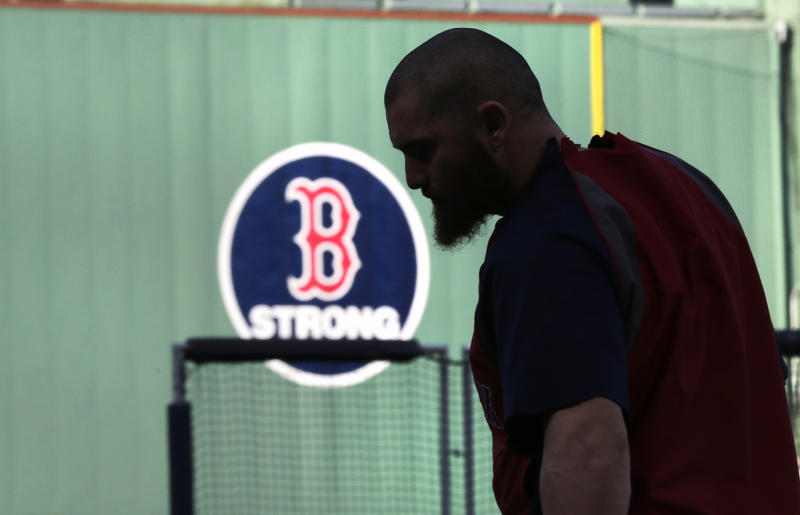 Boston Red Sox's Jonny Gomes heads to home plate to take batting practice during a team workout at Fenway Park, Friday, Oct. 18, 2013, in Boston. The Red Sox will face the Detroit Tigers in Game 6 of the American League baseball championship series on Saturday. (AP Photo/Charles Krupa)