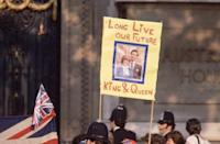 <p>They also relayed messages of support for the royal couple along the procession route. Seeing these signs had to calm Diana's nerves.</p>