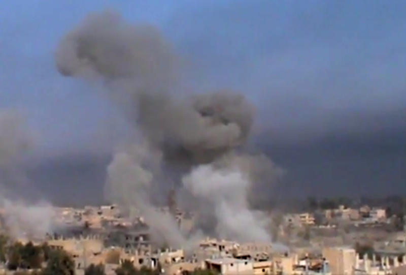 This image made from citizen journalist video posted by the Shaam News Network, which has been verified and is consistent with other AP reporting, shows smoke from shelling in Deir al-Zour, Syria, Wednesday, Nov. 6, 2013. Syria's 23 million people belong to a startling patchwork of different religious groups, and the three-year conflict has taken increasingly sectarian overtones in the past year. (AP Photo/Shaam News Network)