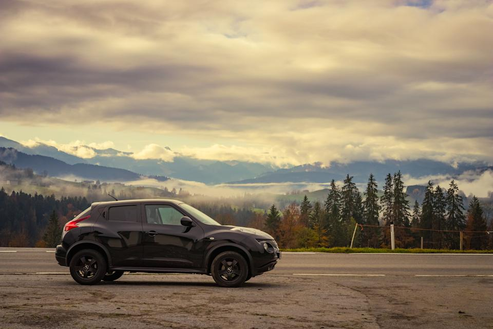 Doren, Austria - November 1, 2019: Black colored 2011 Nissan Juke car parking next to the road on a warm, cloudy autumn morning in a rural area in Vorarlberg, Austria.