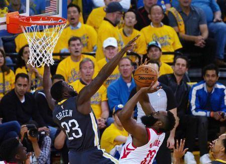 May 22, 2018; Oakland, CA, USA; Houston Rockets guard James Harden (13) shoots against Golden State Warriors forward Draymond Green (23) during the second quarter in game four of the Western conference finals of the 2018 NBA Playoffs at Oracle Arena. Mandatory Credit: Kelley L Cox-USA TODAY Sports