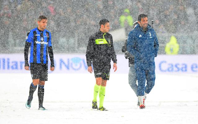 Soccer Football - Serie A - Juventus v Atalanta - Allianz Stadium, Turin, Italy - February 25, 2018 Juventus' Gianluigi Buffon with Atalanta's Rafael Toloi and the referee in the snow as the match was postponed REUTERS/Massimo Pinca