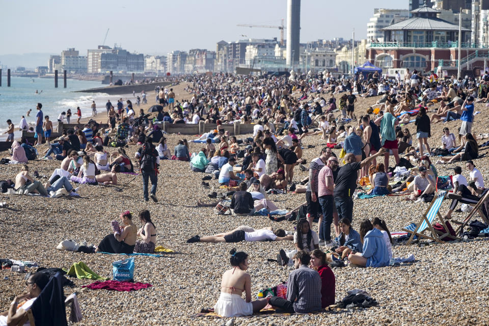 BRIGHTON, ENGLAND - MARCH 30: Crowds head for the beach as a spell of hot weather coincides with lockdown restrictions being eased on March 30, 2021 in Brighton, England. Forecasters are predicting temperatures of 22C (72F), and with the easing of coronavirus lockdown rules many people will be heading for the outdoors. (Photo by Chris Eades/Getty Images)