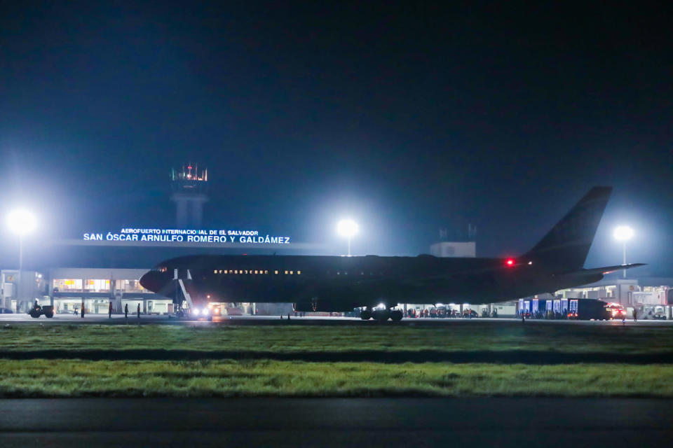 In this photo provided by El Salvador's presidential press office, The New England Patriots team plane is parked on the tarmac of the airport in San Salvador, El Salvador, late Tuesday, May 18, 2021. The team plane has delivered Chinese-made Sinovac COVID-19 vaccines. (El Salvador's presidential press office via AP)