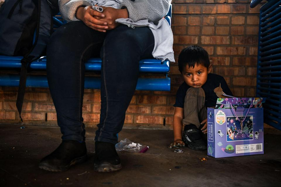 Hundreds of men, women and children are setting off from the  Brownsville bus stationAFP/Getty