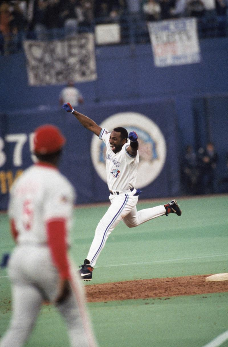 TORONTO,CANADA - OCTOBER 23: Joe Carter #29 of the Toronto Blue Jays celebrates his home run during game six of the 1993 World Series against the Philadelphia Phillies at the Skydome on October 23,1993 in Toronto, Canada. The Blue Jays won 8-6. (Photo by MLB Photos via Getty Images)