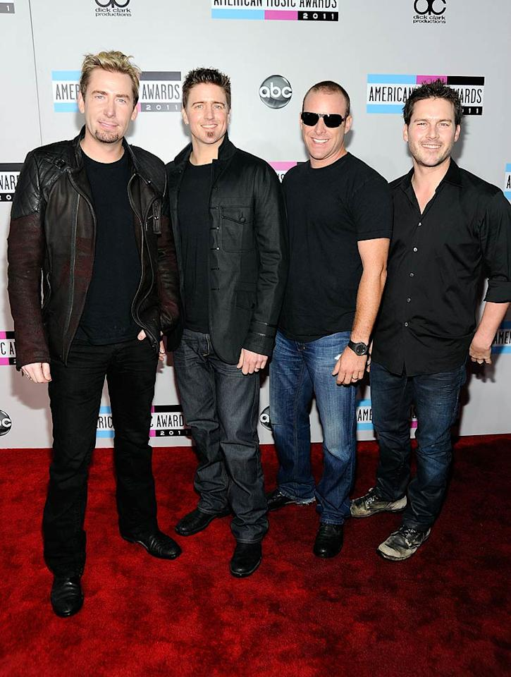 Chad Kroeger, Daniel Adair, Mike Kroeger, and Ryan Peake of Nickelback arrive at the 2011 American Music Awards held at the Nokia Theatre L.A. LIVE. (11/20/2011)