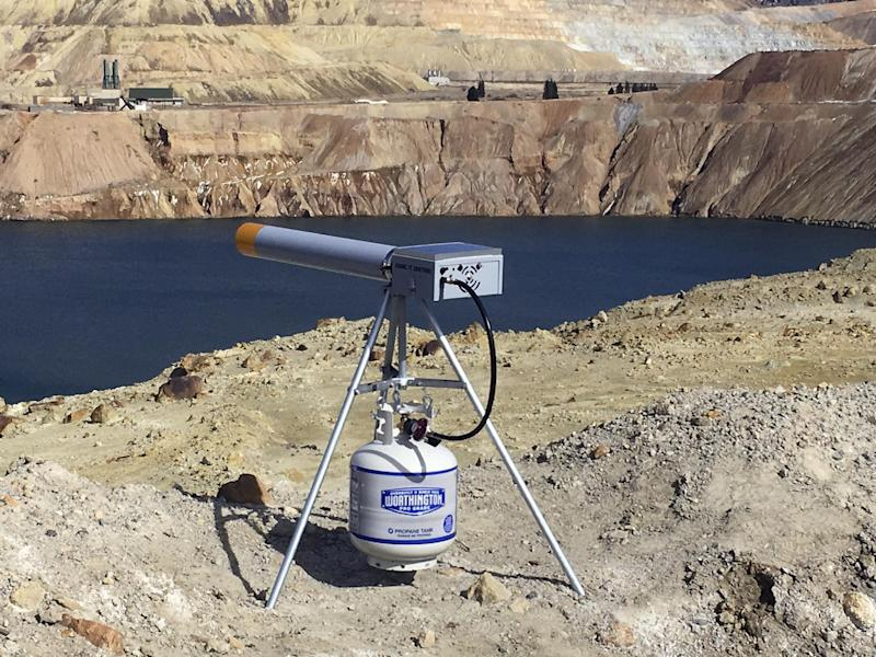 In this photo provided by Montana Resources, a propane-powered noise cannon sits at the edge of the Berkeley Pit in Butte, Montana, on March 3, 2017. The cannon is one of several new measures being taken to keep birds away from the 50 billion gallon toxic pit after 3,000 to 4,000 snow geese died there last fall. (Pete Steilman/Montana Resources, via AP)