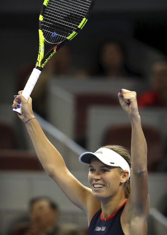 Caroline Wozniacki of Denmark reacts after beating Anastasija Sevastova of Latvia in the women's singles final in the China Open at the National Tennis Center in Beijing, Sunday, Oct. 7, 2018. (AP Photo/Mark Schiefelbein)