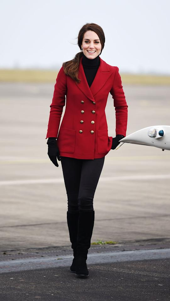 <p>The Duchess spent Valentine's Day with young Air Cadets at an RAF base near Peterborough. She suitably wore a military-inspired look featuring a double-breasted red jacket by Philosophy di Lorenzo Serafini and her favourite suede Stuart Weitzman boots.</p><p><i>[Photo: PA]</i></p>