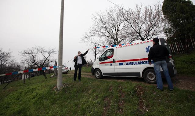 An ambulance arrives in the village of Velika Ivanca, Serbia, Tuesday, April 9, 2013. A 60-year-old man gunned down 13 people, including a baby, in a house-to-house rampage in the quiet village on Tuesday before trying to kill himself and his wife, police and hospital officials said. Belgrade emergency hospital spokeswoman Nada Macura said the man, identified only as Ljubisa B., used a handgun in the shooting spree at five houses. The dead included six women. (AP Photo/Darko Vojinovic)