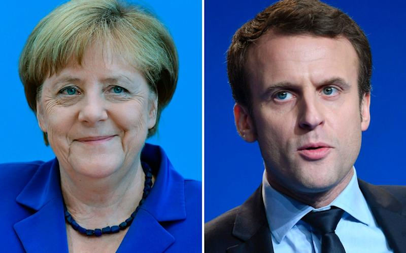 Angela Merkel froze Emmanuel Macron out of EU negotiations with Greece after he called the debt deal a 'modern-day version of the Versailles Treaty,' a new book claims. - AFP