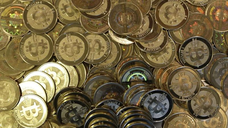 This April 3, 2013file photo shows bitcoin tokens at 35-year-old software engineer Mike Caldwell's shop in Sandy, Utah.